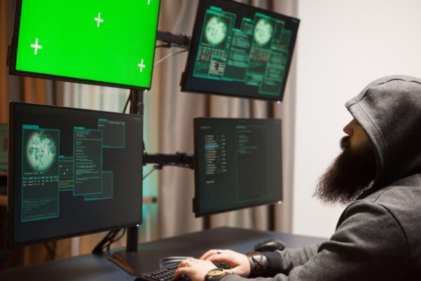 Bearded man hacking his government servers