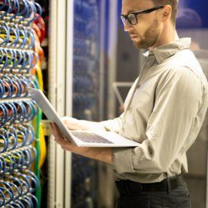 Programmer examining server