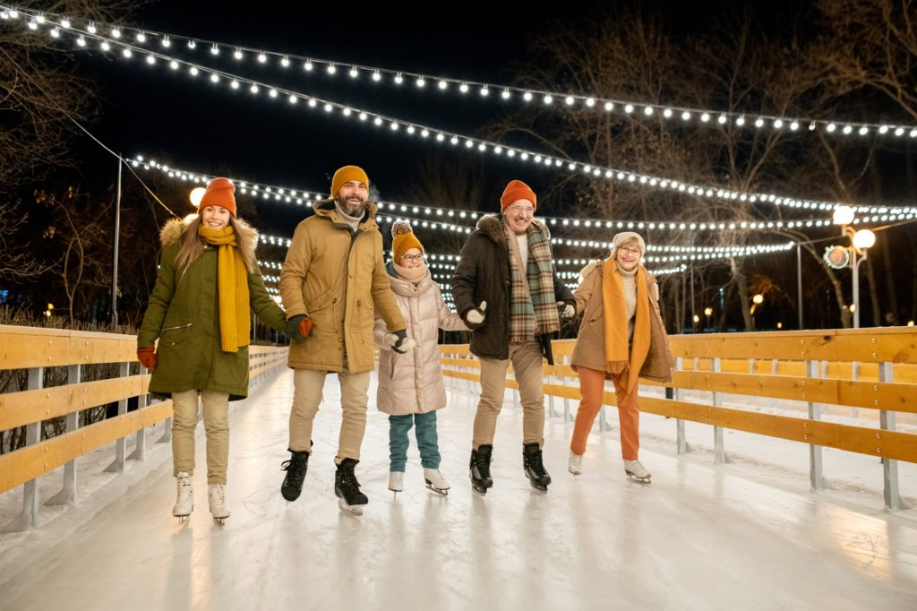 Big family on skating rink